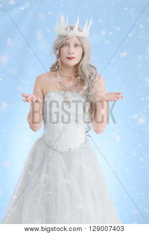 portrait of beautiful ice queen making snow