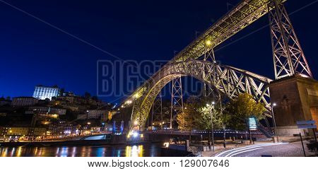 City of Porto by night in Portugal, the Old Town and Ponte Dom Luiz I arch bridge over Douro river.