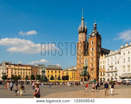 KRAKOW, POLAND - CIRCA 2011: St. Mary's Church on Main square in Krakow on a summer day, Poland in circa 2011