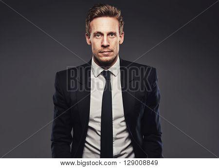 Portrait Of Handsome Business Man In Dark Suit