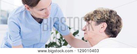 Helpful Nurse And Sick Patient