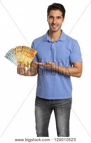 A Businessman Showing Brazilian Money