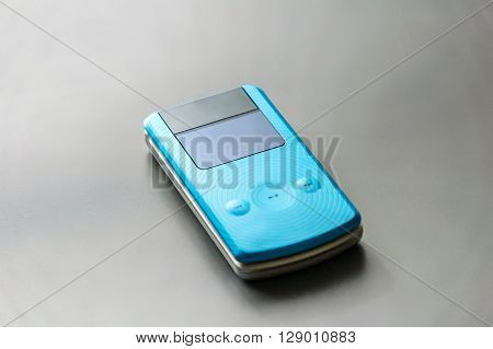 Mobile phone on grey background with clipping path.