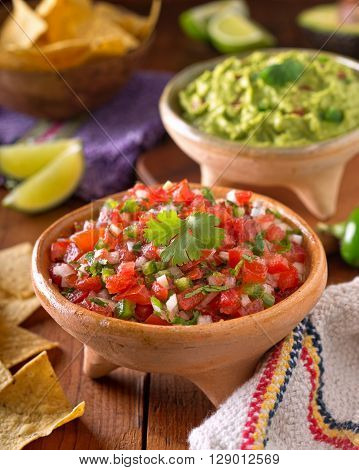 A delicious home made salsa pico de gallo with tomato onion lime cilantro and jalapeno pepper.