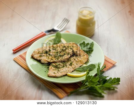 breaded cutlet with herbs and mustard, selective focus