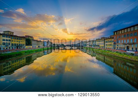 FLORENCE, ITALY - JUNE 12, 2015: Ponte Santa Trinita or Holy Trinity Bridge in Florence, oldest bridge around the world.