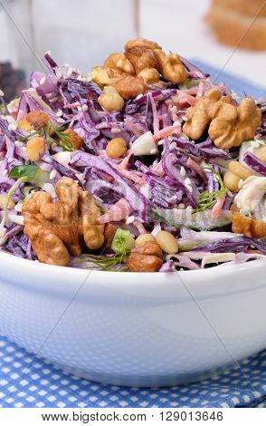 salad of shredded red cabbage with nuts in milk sauce