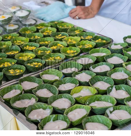 Steamed flour with coconut filling sweetmeat in market