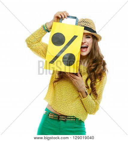 Woman Hiding Behind Shopping Bag Symbolising Beginning Of Sales