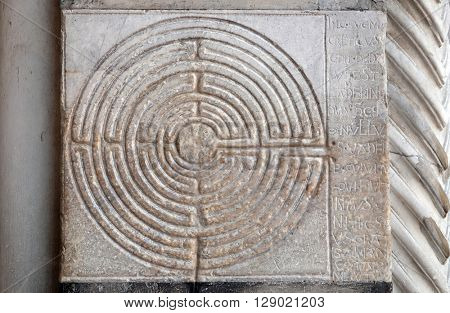 LUCCA, ITALY - JUNE 06, 2015: Ancient Labyrinth. Curious stone placed on Cathedral of St Martin in Lucca, Italy, on June 06, 2015