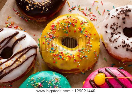 donuts in glaze close-up on a wooden background