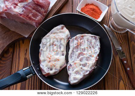 Pieces Of Meat In Mayonnaise With Spices In A Pan