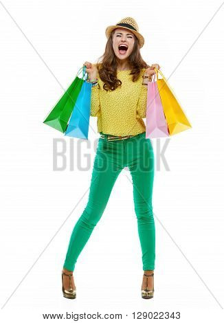 Woman In Hat And Bright Clothes With Shopping Bag Rejoicing