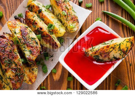 Delicious Fried Potatoes With Ketchup And Fresh Herbs