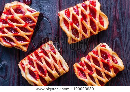 Strudel With Cherry Jam On A Black Background