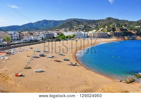 a panoramic view of the Platja Gran beach in Tossa de Mar, in the Costa Brava, Spain