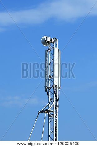 Mast of cellular communication with microwave radio antenna equipment