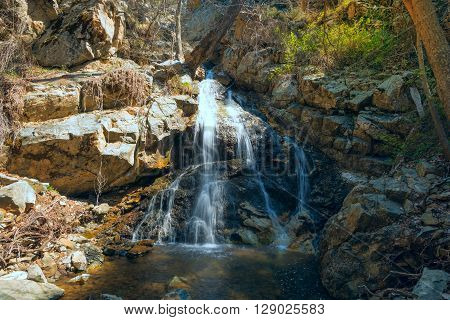 Small waterfall in the mountains on a sunny morning not far from the waterfall Kalidonia Troodos Cyprus.