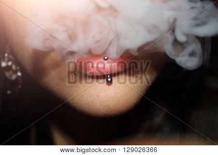 The Girl With The Pierced Lip Produces The Smoke Cigarettes