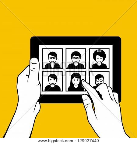 Hands with tablet pc - looking through photos on dating website