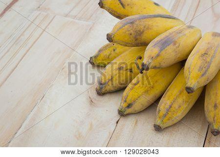 Pisang Awak banana Kluai Nam Wa Cultivate banana on wooden background copyspace.