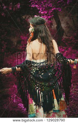 boho girl in infrared garden back view