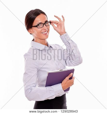 Smiling Brunette Businesswoman Carrying A Tablet