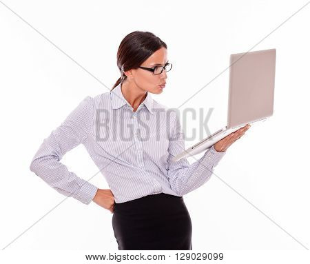 Unsatisfied Brunette Businesswoman With A Laptop