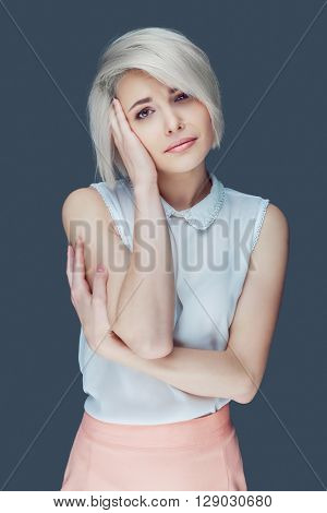 unhappy woman, isolated against grey background