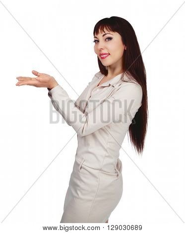 smiling brunette woman with her hands up, place your product here, isolated against white studio  background