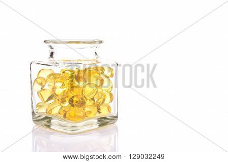 Fish Oil Capsules In Translucent Bottle On White Background