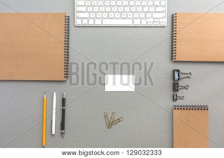 Mock Up Template of Stationary and Tools in Office Every Day Life Top View Directly from Above with Blank Business Card in Centre