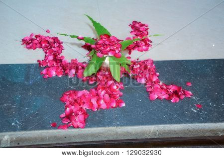 Swastik Created With Pink Rose  For Welcoming New Bride And Groom