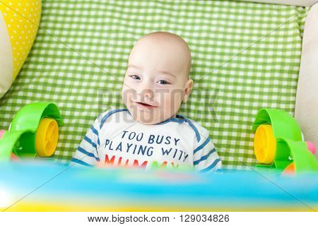 Closeup of a smiling baby boy looking at photographer