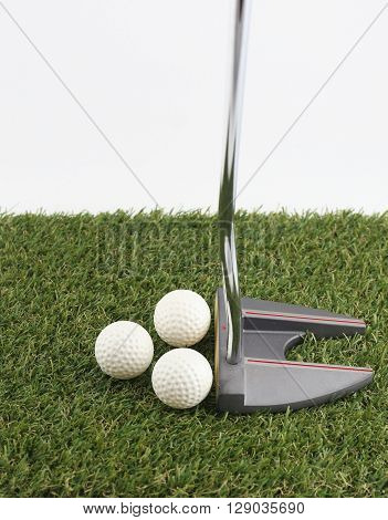 Golf putty and ball on green white background