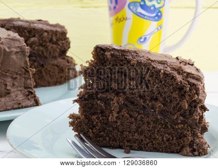 Rustic slice of chocolate cake on blue plate