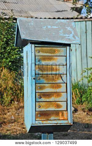 Rusty vintage mail box on old street