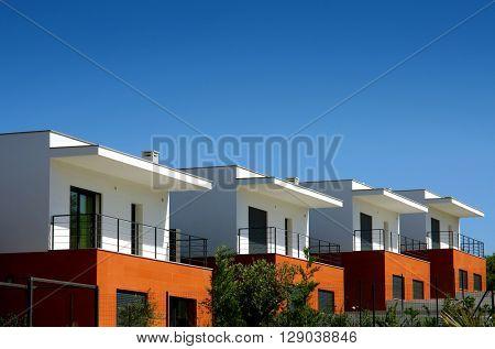 Facades of a modern houses condominium in a sunny day