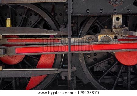 Detail of two wheels of a vintage steam train locomotive