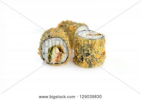 three fresh and tasty sushi rolls on white