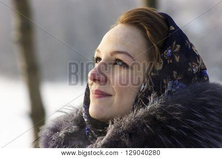 Portrait of russian beauty in frosty sunny day