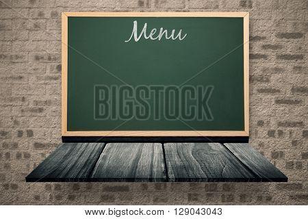 Menu message against blackboard on a wooden shelf