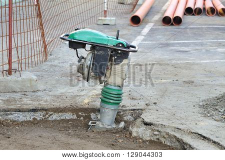 Gasoline Or Diesel Vibratory Plate Compactor At Road Construction Site