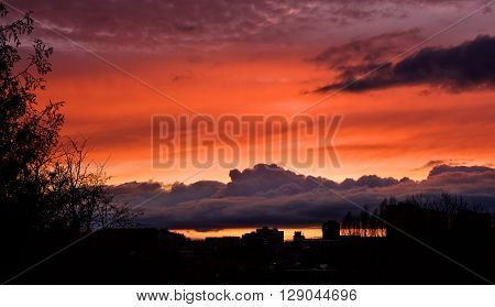 City view on sunset, buildings silhouettes in colourful sunset, evening in the city, dramatic colourful sunset sky in the city with buildings silhouettes, sunset vin Vilnius