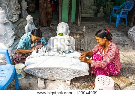 Mandalay Myanmar - January 13 2012: Marble workers prepearing Buddha statues.