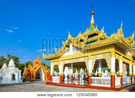 Mandalay Myanmar - January 13 2012: Locals and tourists in the Shwenandaw Kyaung golden pagoda sanctuary.