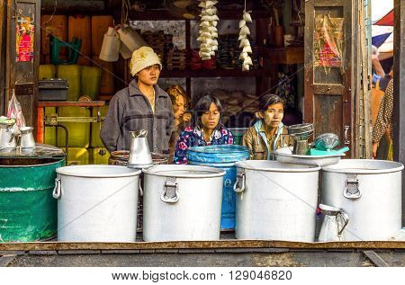 Bagan Myanmar - January 12 2012: Local women in a street market.