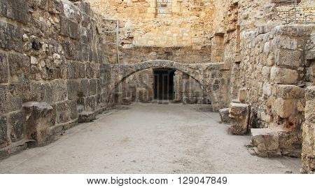 Excavated archeological arch in the Pool of Bethesda and Byzantine Church.  Located in the Muslim Quarter in Old Jerusalem, Israel on the path of the Beth Zeta Valley.