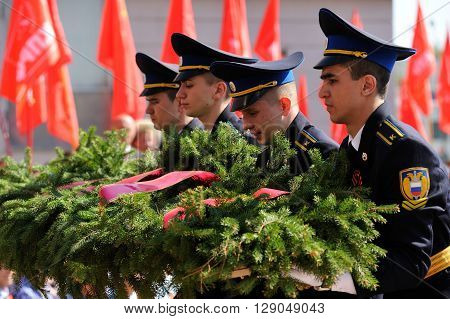 Orel Russia - May 9 2016: Celebration of 71th anniversary of the Victory Day (WWII). Military men laying funeral wreath closeup selective focus