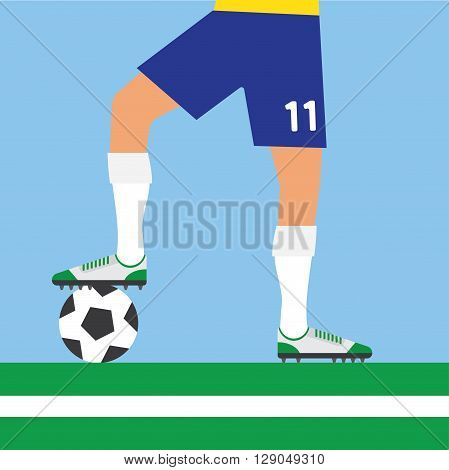 soccer player rests foot on soccer ball football